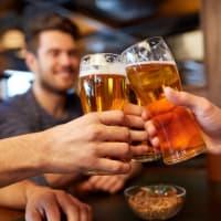 A group of guys enjoying a pint