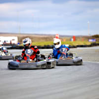 A man in a go kart racing around a track