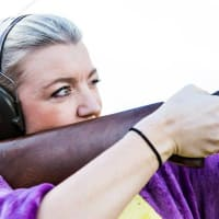 A woman on a hen party clay pigeon shooting