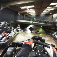 A group race go karts around a track