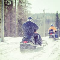 Two men on snowmobiles