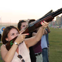 Group doing laser clay pigeon shooting