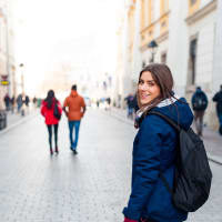 Young woman tourist in the city of Krakow , Poland, visiting the city.