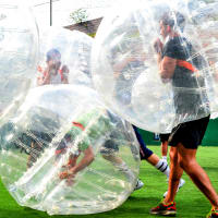 Men playing Zorb football