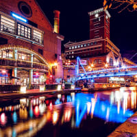 A busy brightly lit canal in Birmingham