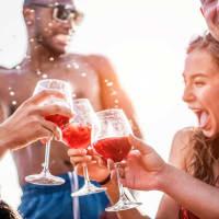 group of friends on boat drinking sangria enjoying sunshine