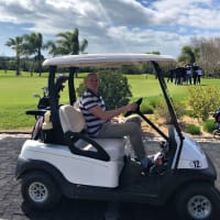Man in A Golf Buggy