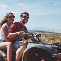 man and woman on quad bike