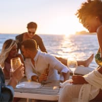 friends having fun and drinks on boat party
