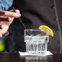 man serving gin drink