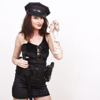 Sexy woman dressed as policewoman stripper