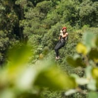 A woman going down a zip line