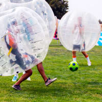 A group playing zorb football