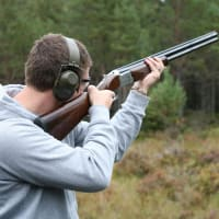 A man shoots clay pigeons