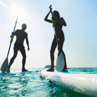 two people doing stand up paddle boarding