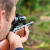 A man shoots an air rifle