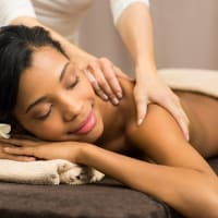 a woman receiving a massage during pampering session