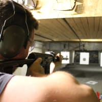 A man shoots an AK47