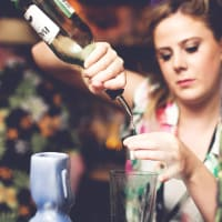 woman enjoying a cocktail making class