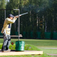 Man shooting gun during clay pigeon event