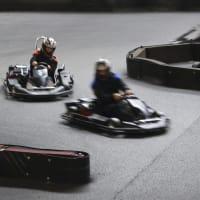 A group racing go karts around a track