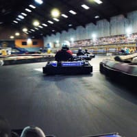 People race around a go kart track