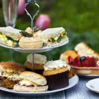 Cakes on a cake tray for afternoon tea