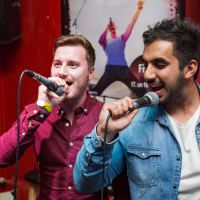 Riga Bar Crawls Karaoke Bar Stag couple singing