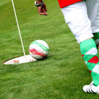 A man playing footgolf