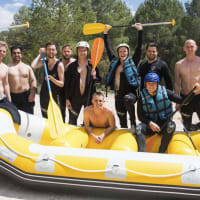 A happy stag group doing white water rafting