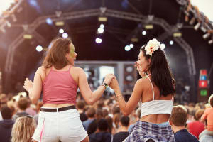 two girls having fun at a festival