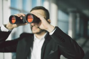 spy with binoculars