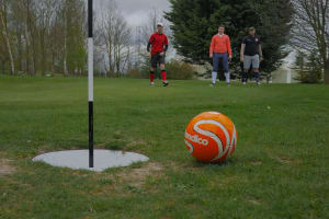 man playing foot golf