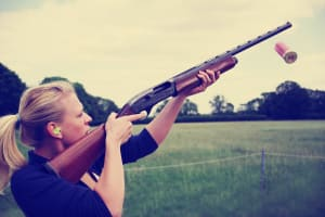 A woman shooting during clay pigeon activity