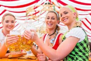 A group of bavarian women enjoying beers_stock