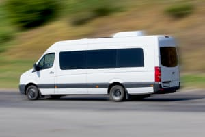 A minibus driving on a road