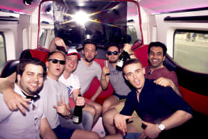 A stag group celebrate in a party bus