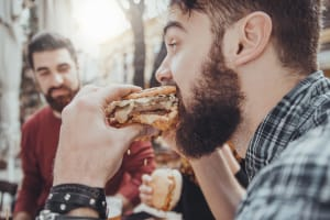 A stag party eating burgers