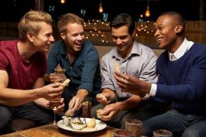 Group of guys sharing platter