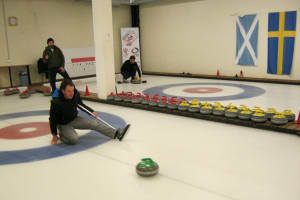 Kerlinga Halle - Man delivering curling stone