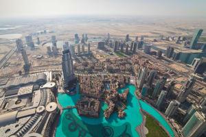View on Downtown Dubai from Burj Khalifa at sunny morning, United Arab Emirates.