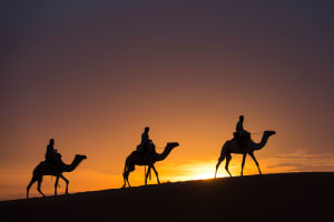 sunset camel trek three rides in desert Dubai