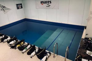 discover scuba diving pool inside with equipment