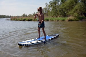 man doing Stand Up Paddleboarding