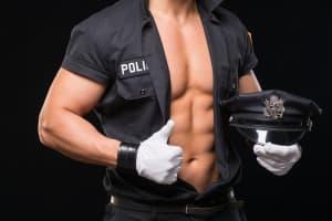 man dressed as sexy policeman