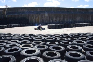 A driver races around a go karting track