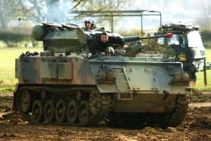 A stag party driving a tank