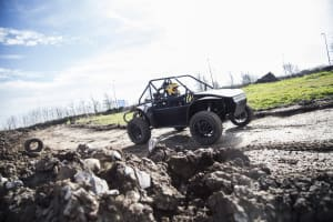 An image of a man driving an off road buggy