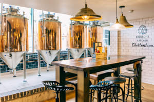 Brewhouse & Kitchen Cheltenham seating and brew tanks
