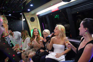 Women having fun on a party bus